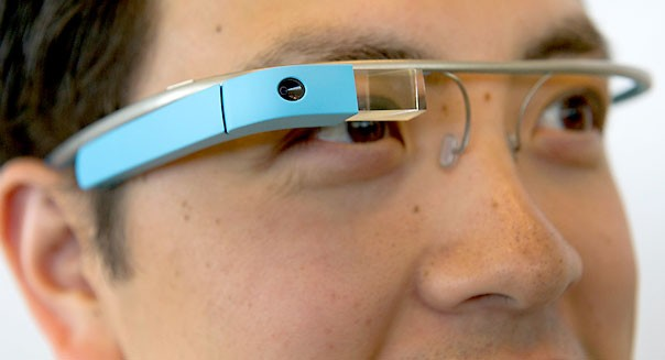 Google Inc employee Ray Liu, wears Project Glass internet glasses during a demonstration during at the Google I/O conference in San Francisco, California, U.S., on Wednesday, June 27, 2012. Google Inc. unveiled a $199 handheld computer called the Nexus 7 that features a 7-inch screen and is designed to help the company vie with Apple Inc., Microsoft Corp. and Amazon.com Inc. in the surging market for tablets. Photographer: David Paul Morris/Bloomberg via Getty Images