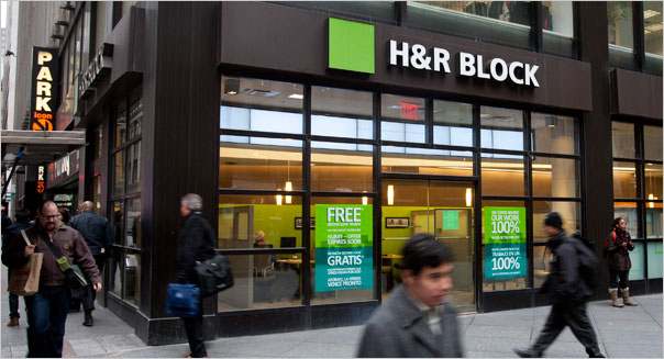 Pedestrians walk past the H&R Block Inc. flagship office in New York, U.S., on Friday, March 2, 2012. H&R Block Inc. provides tax services to the general public, accounting and consulting services, and consumer financial and personal productivity software. Photographer: Scott Eells/Bloomberg via Getty Images