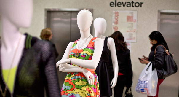 A mannequin stands as customers wait for the elevator at a J.C. Penney Co. store in the Queens borough of New York, U.S., on Tuesday, Feb. 26, 2013. Confidence among U.S. consumers jumped more than forecast in February as Americans adjusted to a higher payroll tax and signs of a recovering housing market spurred faith in the future. J.C. Penney Co. is scheduled to release earnings data on Feb. 27. Photographer: Victor J. Blue/Bloomberg via Getty Images