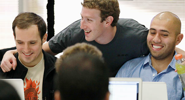 PALO ALTO, CA - OCTOBER 06: Facebook founder and CEO Mark Zuckerberg (C) greets Facebook employees before speaking at a news conference at Facebook headquarters> on October 6, 2010 in Palo Alto, California. Zuckerberg announced changes to the popular social networking site. (Photo by Justin Sullivan/Getty Images)