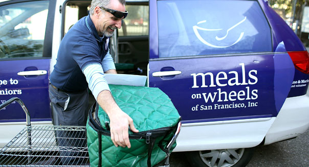 SAN FRANCISCO, CA - FEBRUARY 27:  Meals On Wheels of San Francisco driver Jim Fleming loads meals into a van before making deliveries on February 27, 2013 in San Francisco, California.  Programs for the poor like Meals On Wheels, which delivers meals to homebound seniors, could be affected if $85 billion in federal spending cuts come down due to sequestration.  (Photo by Justin Sullivan/Getty Images)