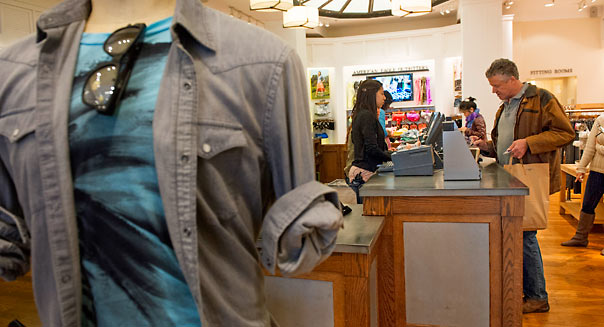 A customer makes a transaction at an American Eagle Outfitters Inc. store in San Francisco, California, U.S., on Wednesday, March 6, 2013. American Eagle reported adjusted fiscal year 2012 earnings for the 53 weeks ended February 2, 2013 of $1.39 per share, a 43% increase from fiscal year 2011 adjusted earnings. Photographer: David Paul Morris/Bloomberg via Getty Images