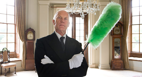 Wealthy man with a feather duster