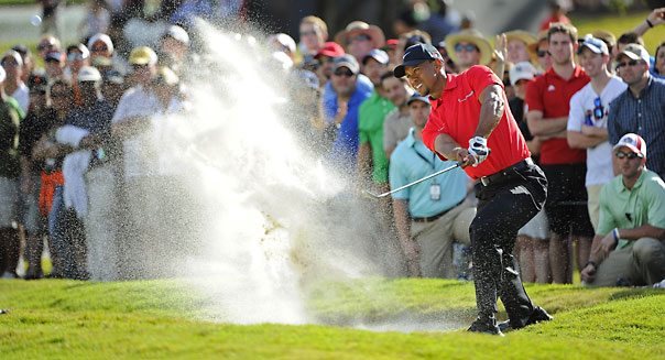 DORAL, FL - MARCH 10:  Tiger Woods hits from a bunker on the 12th hole during the final round of the World Golf Championships-Cadillac Championship at TPC Blue Monster at Doral on March 10, 2013 in Doral, Florida. (Photo by Chris Condon/PGA TOUR)