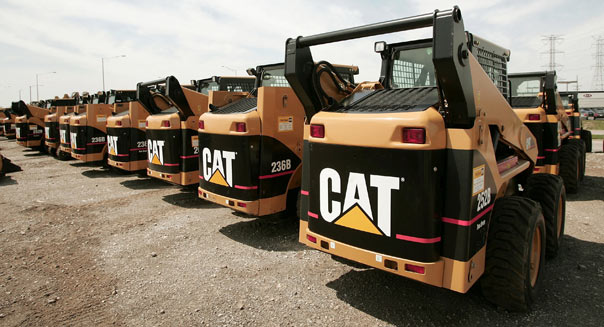 FILE - JANUARY 28: According to reports January 28, 2013, Caterpillar Inc, posted a 55 percent drop in fourth quarter profit due to charges taken from accounting fraud at a Chinese subsidiary and a high inventory due to the global economic slow down. ELMHURST, ILLINOIS - APRIL 24: Caterpillar earth moving equipment is displayed at Patten Industries on April 24, 2006 in Elmhurst, Illinois. Heavy equipment maker Caterpillar reported first-quarter earnings higher than forecasted at $840 million, up 45 percent from $581 million during the same period in 2005. (Photo by Scott Olson/Getty Images)