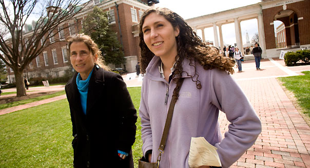 Alex Grieb, age 18, and her mother Joy Cohen, both of New Orleans, Louisiana, tour the campus at Johns Hopkins University during a welcoming for admitted students in Baltimore, Maryland, U.S., on Tuesday, April 7, 2009. Johns Hopkins and other schools such as Amherst College, Cornell University and Bowdoin College are planning to increase student populations, according to the schools' admissions and public-relations officials. Photographer: Dennis Drenner/Bloomberg News