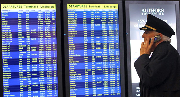 MINNEAPOLIS, MN - MARCH 23: A pilot checks out flight delays at the Minneapolis St. Paul International Airport. (Photo by Bruce Bennett/Getty Images)