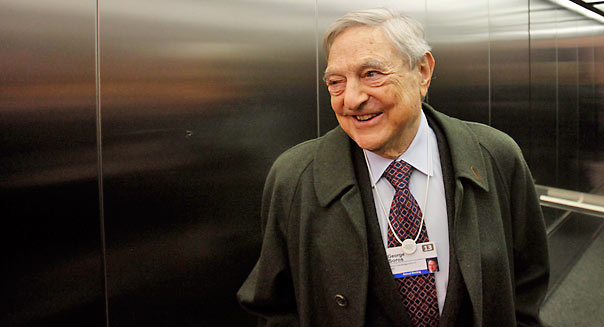 George Soros, founder of Soros Fund Management LLC, takes a lift inside the congress center **Photographer: Simon Dawson/Bloomberg *** Local Caption ***