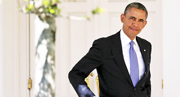 WASHINGTON, DC - APRIL 03: U.S. President Barack Obama walks from the Oval Office to the White House residence before departing on Marine One April 3, 2013 in Washington, DC. Obama is scheduled to travel today to Colorado and California. (Photo by Win McNamee/Getty Images)