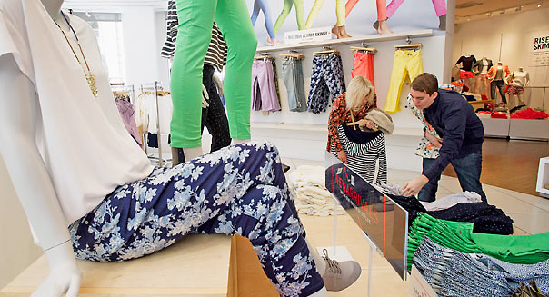 Store manager Ryan Shearer helps a customer at a Gap Inc. store. David Paul Morris/Bloomberg via Getty Images