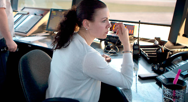 Air traffic controller specialist Mamie Ambrose, right, works at the Frederick Municipal Airport control tower in Frederick, Maryland, U.S., on Wednesday, March 27, 2013. The U.S. will close 149 air-traffic control towers run by contractors at small and mid-sized airports beginning on April 7 as a result of automatic budget cuts at government agencies, known as sequestration. The Frederick Municipal Airport control tower is one of contract towers on the Federal Aviation AdministrationÕs (FAA) closure list. Photographer: Andrew Harrer/Bloomberg *** Local Caption *** Mamie Ambrose