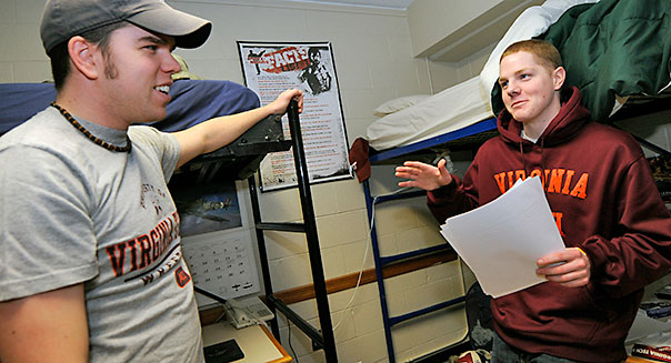 Virginia Tech senior and resident advisor, David Dorsett, left, chats with fellow dorm resident and freshmen, Ross Cooper of Richmond, Virginia, in Lee Hall on the campus of Virginia Tech in Blacksburg, Va., Monday, Feb.22, 2010. (AP Photo/Don Petersen)