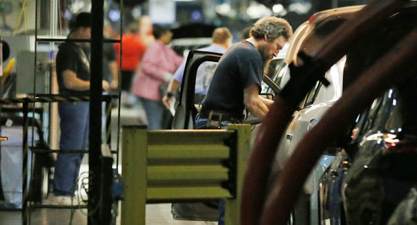 march factory orders workers assembly line manufacturing