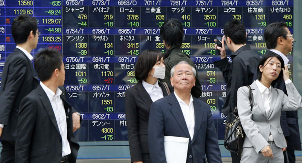 passersby electronic stock board tokyo global markets