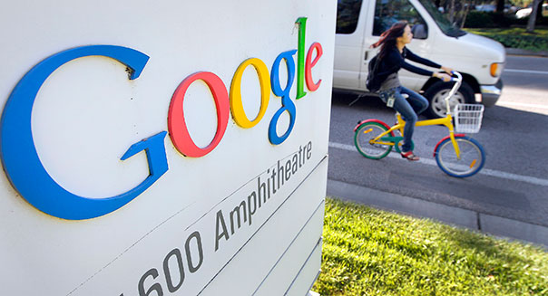 Google Inc. signage is displayed as an employee rides a
