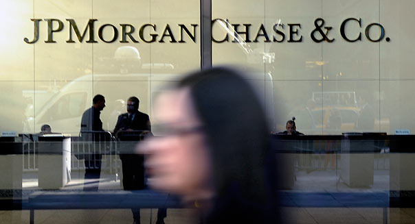 A pedestrian walks past JP Morgan Chase & Co. Headquarters in New York, U.S., on Friday, May 11th, 2012. Photographer: Peter Foley/Bloomberg *** Local Caption ***