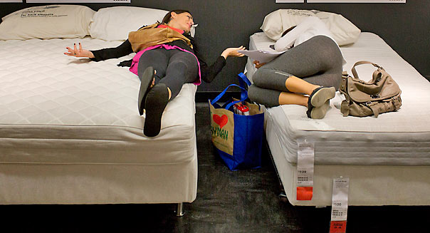 Two shoppers try out the beds in the showroom at the Ikea store in Brooklyn, NY, Wednesday, September 26, 2012. Photograph: Victor J. Blue