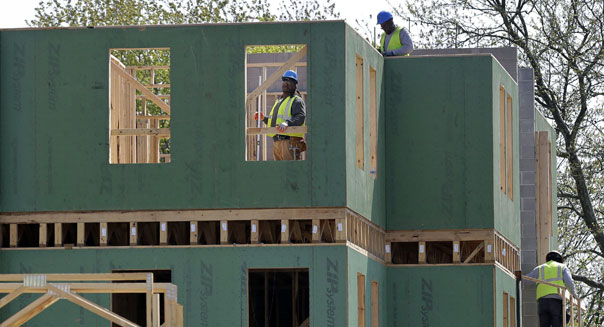 construction workers building new home