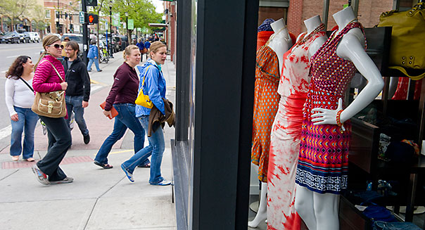 BOZEMAN, MT - MAY 18: Pedestrians pass by the front window display at Meridian, a downtown boutique on Main Street after shopping for clothes on May 18, 2013 in Bozeman, Montana. Meridian underwent construction and just reopened. Photo by Ann Hermes/The Christian Science Monitor