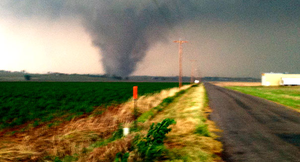 This photo provided by Shelby Barrow shows a tornado near Chickasha, Okla., Tuesday, May 24, 2011. A line of violent thunderstorms roared across middle America on Tuesday, killing six people in two states, with several tornadoes touching down in Oklahoma and high winds pounding rural Kansas. (AP Photo/Shelby Barrow) MANDATORY CREDIT
