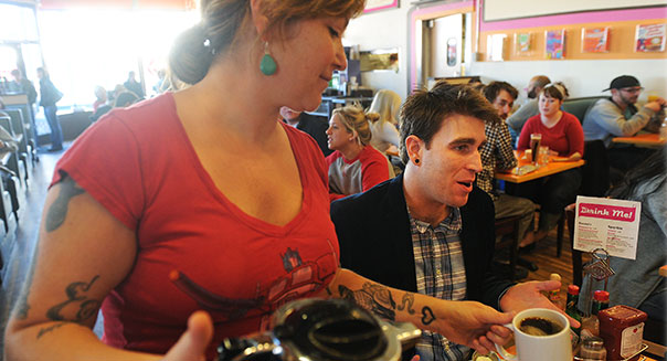 Samuel Schimek founder of I HEART Denver store in Denver at the restaurant Jelly and the Kirkland Museum on Tuesday, March 20, 2012. Waitress Christina Smith pours coffee at Jelly. Cyrus McCrimmon, The Denver Post