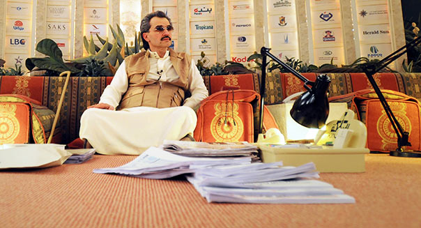 Prince Alwaleed reading at the desert camp in Riyadh.KSA ,Wednesday, April 28, 2010. WASEEM OBAIDI