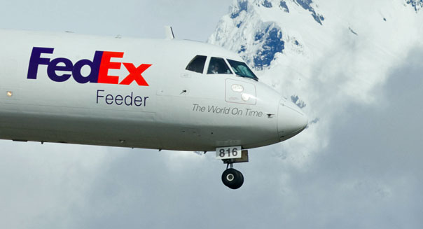 fedex earnings fuel costs economic bellweather shipping parcel service