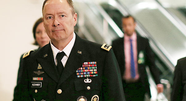 WASHINGTON, DC - JUNE 13: U.S. Army Gen. Keith Alexander, Director National Security Agency (NSA), and head of the US Cyber Command walks to a closed door U.S. Senate Intelligence Committee meeting, June 13, 2013 in Washington, DC. The committee is hearing testimony from members of the intelligence community on the collection of personal data that helped the NSA thwart a number of terror plots from ever unfolding both domestically and abroad. (Photo by Mark Wilson/Getty Images)