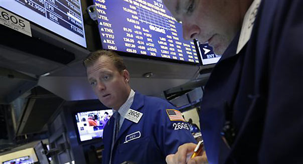 Despite mergers, stocks decline ahead of Fed meeting