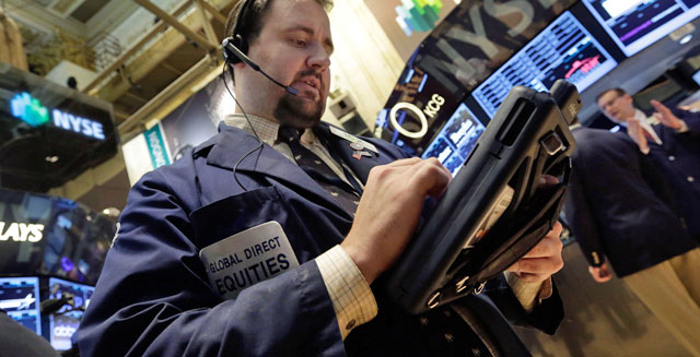 new york stock exchange floor traders economic earnings reports profits economy