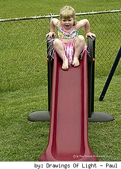 child playing on a slide
