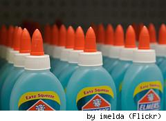 Bottles of Elmer's glue, by Flickr user Imelda.