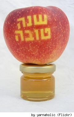 Honey with special Rosh Hashanah apple, by Flickr user Yarnaholic.