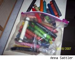 big toddler crayons spilling out of a ziploc bag