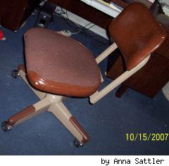 brown leather and brown fabric ugly office chair