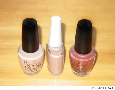 Nail polish bottles (OPI and Shu Uemura) by M.E. Williams