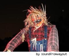 scary pumpkin face scarecrow