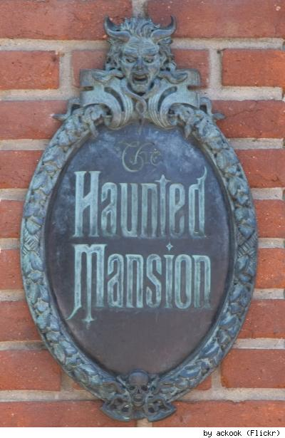 The iconic Haunted Mansion sign, by Flickr user AckOok.