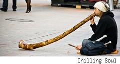 man playing didgeridoo