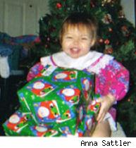 Samantha holding Christmas presents