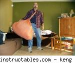 Keng with his gigantic furoshiki bag. Fair use size, from instructables.com.