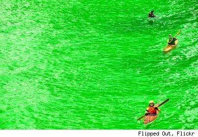 Green Chicago River with kayakers, by Flickr user Flipped Out.
