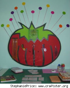 Tool pegboard shaped like tomato pincushion. Cute!