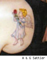 tattoo of a cherub in a light blue dress holding a red rose