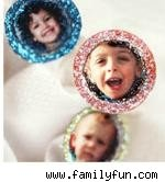 three bottle cap brooches with children's photos and glitter