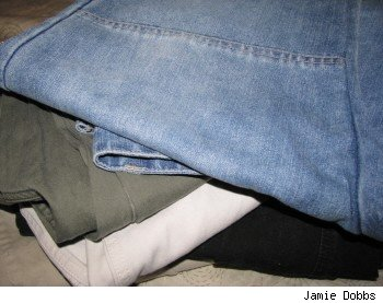 A stack of jeans and trousers