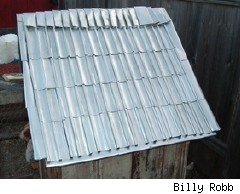 beer can roof on chicken coop