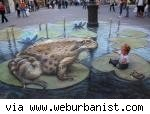 sidewalk art of frog on lily pad