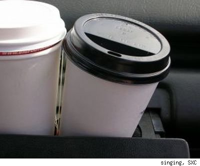 SXC image of two white paper coffee cups with to-go lids attached