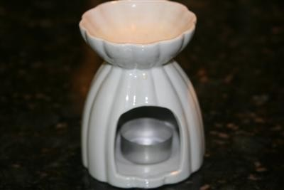 white tart burner with tealight candle